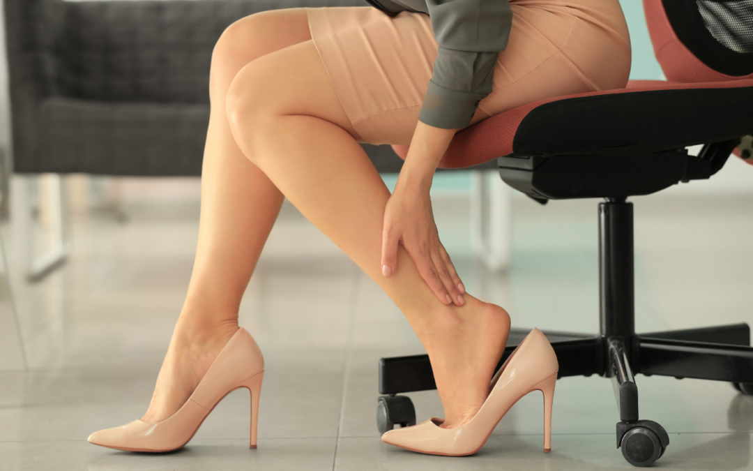 Woman holding leg due to pain of sitting all day